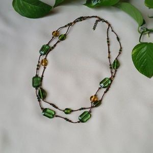 Green and yellow beaded necklace, knotted cord